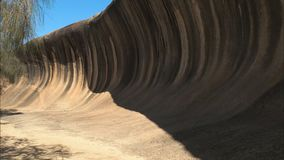 Wave rock in western australia panning shot stock video
