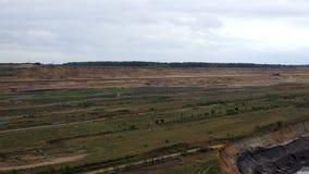 Tagebau Hambach: strip mining lignite panning shot. Wide angle panning shot of a huge strip mine used for mining lignite stock video footage
