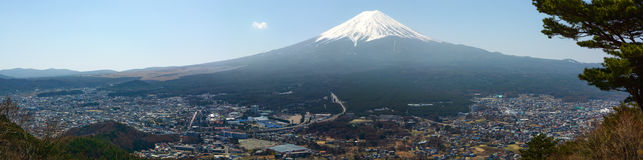 Wide angle panorama of snow-capped Mount Fuji and the small town of Fujikawaguchiko in Japan Stock Photo