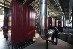 Wide-angle panoramic photo of the newest alternative fuel boiler room with pipes, towers and tanks, on a clear summer day royalty free stock photography