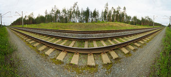 Wide-angle panoramic photo of railroad tracks Royalty Free Stock Photos
