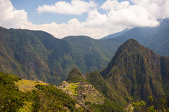 Wide angle panoramic view of Machu Picchu, illuminated by afternoon sunlight, and the majestic Urubamba Valley from the Inca Trail Stock Photo