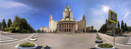 Wide angle panoramic view of main building of Moscow State University in sunny day with blue sky Stock Photos
