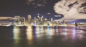 Wide angle picture of New York skyline at night. Wide angle picture of New York City skyline at night, color toned picture, USA Royalty Free Stock Image