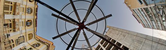 Part of a Fan between buildings. A wide angle picture of a part of a big fan between buildings,in  a Greek town,Thessaloniki Stock Photography