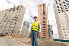 Wide angle portrait of construction foreman standing on building. Wide angle portrait of young construction foreman standing on building site royalty free stock images