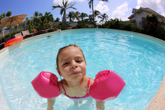 Wide angle portrait of a little gril swimming in the pool Stock Image