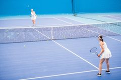 Two Sportswomen Playing Tennis in Court royalty free stock images