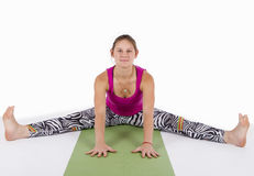 Wide-Angle Seated Forward Bend pose Royalty Free Stock Images