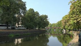 Landwehr canal in Berlin, Germany. Wide angle shot along the Landwehr canal in Berlin, Germany, on a beautiful late summer day stock video