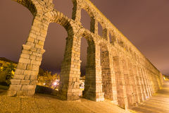 Wide angle shot of  antique roman aqueduct. In  early morning.  Segovia, Spain Royalty Free Stock Image