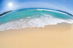 Wide angle shot of beach with blue sky Stock Photos