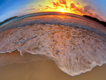 Wide angle shot of beach sand on sunset Royalty Free Stock Photo