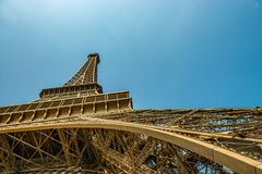 Wide angle shot of the eiffel tower. The french Eiffel tower in paris, seen from below, showing the arc, bottom and top in a spectaculair wide angle view Royalty Free Stock Images