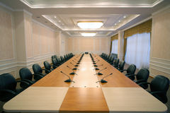Wide angle shot of empty meeting conference room. With mics Stock Photography