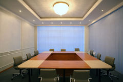 Wide angle shot of empty meeting conference room. With square table Royalty Free Stock Photos