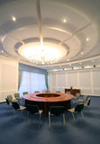 Wide angle shot of empty meeting conference room. With round table Royalty Free Stock Photos