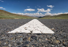 Wide-angle shot of empty road markings on asphalt in Mongolia be Royalty Free Stock Photo