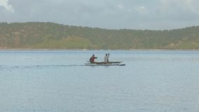 Fishermen in boat. A wide angle shot of fishermen in small boat moving from one point to another stock video footage