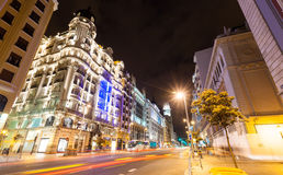 Wide angle shot of Gran Via street in night. Madrid, Spain Royalty Free Stock Image