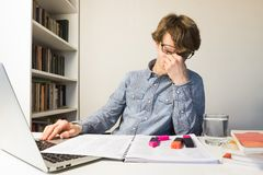 Male person rubbing tired eyes meeting deadline for school or work project stock images
