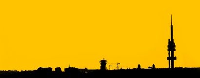Wide angle shot of the industrial city silhouette. Wide angle shot of the silhouette of industrial city skyline against the yellow sky in summer evening Royalty Free Stock Images