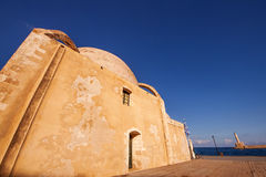 Wide angle shot of Janissaries mosque in the Old Port of Chania. Crete Royalty Free Stock Photography