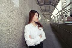 Wide angle shot of leadership young Asian business woman standing and looking confident against urban background. royalty free stock photo