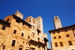 A wide angle shot of Piazza Della Cisterna in San Gimignano, a world heritage site in Tuscany Royalty Free Stock Image