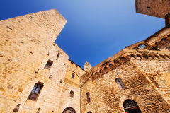 A wide angle shot of Piazza Della Cisterna in San Gimignano, a world heritage site in Tuscany Stock Photos