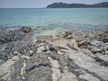 Wide-angle shot of some rocks. That join the crystalline sea of southern Sardinia stock images