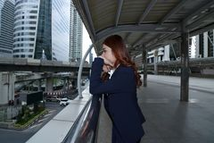Wide angle shot of stressed frustrated young Asian business woman  feeling tired or disappointment at urban city background. Wide angle shot of stressed Stock Images
