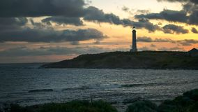 Wide angle shot of cape leeuwin lighthouse at sunset. Wide angle shot of a sunset at west australia`s cape leeuwin lighthouse, situated at the most south stock photo
