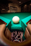 Wide angle shot white ball in billiard pocket Royalty Free Stock Photo