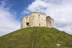 Wide angle shot of the York Castle - Cliffords Tower - against a. Beautiful wide angle shot of the York Castle - Cliffords Tower - against a deep blue sky and Stock Photography