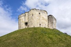 Wide angle shot of the York Castle - Cliffords Tower - against a. Beautiful wide angle shot of the York Castle - Cliffords Tower - against a deep blue sky and Stock Photos