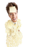 Wide angle shot of young man with a sticky notes. Wide angle shot of young man with a sticky note on his face, covered with yellow stickers, isolated on white Royalty Free Stock Photo