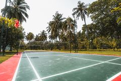 Badminton court in Maldives resort, wide angle shot. Wide-angle side view of the badminton court located in luxury resort in the Maldives: red and green marked royalty free stock images