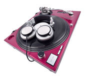 Wide Angle Turntable and Headphones. A wide angle shot of a cherry red turntable with headphones Stock Images