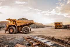 Wide angle of two Large Mining Dump Trucks for transporting ore rocks. Wide angle view of two Large Mining Dump Trucks for transporting ore rocks at Platinum Royalty Free Stock Photo