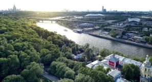 Wide angle vibrant view of sunny Sparrow Hill area in Moscow with boats, stadium, river, bridge and light leaks. Wide angle vibrant view of sunny Sparrow Hill stock image