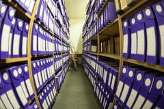 Wide angle view at archive room with papers documents and blueprints. Wide angle view at archive room and storage with papers documents and blueprints stock photo