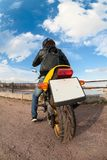 Wide angle view at the back of motorcyclist on bike with clear blank license plate Stock Photo
