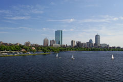 Wide angle view of boston. View of the boston skyline from across the charles river, the water is choppy and there are sailboats in the water Stock Images