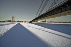 The wide angle view of the bridge over the city. Royalty Free Stock Photography
