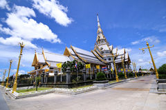 Wide angle view of Buddha building incloudy sky at Wat Sothornvorawiharn, Thailand. Royalty Free Stock Image
