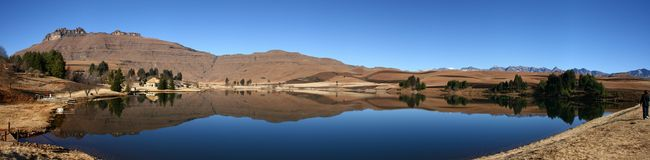 Wide Angle View of Castleburn Dam. Drakensberg, South Africa and recently burnt grass Royalty Free Stock Photos