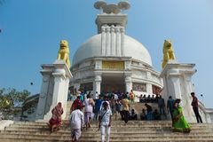 Wide angle view of dhauli temple with visitors royalty free stock image