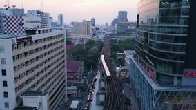 Wide angle view of elevated monorail train, passing between skyscrapers in Shimbashi Financial district. View from the. Top of the town where passing trains stock video footage
