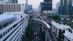 Wide angle view of elevated monorail train, passing between skyscrapers in Shimbashi Financial district. View from the. Top of the town where passing trains stock video